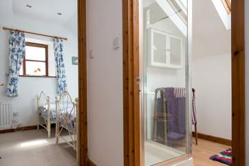 The shower-room is conveniently situated between the two bedrooms.