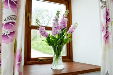 Flowers on the window sill.