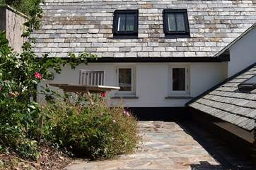 This is the upper terrace at the back of the cottage - the windows are for Bedroom 2.