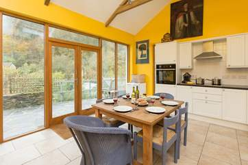 The cottage has a wonderful double height contemporary kitchen/dining room area with doors to the main terrace.
