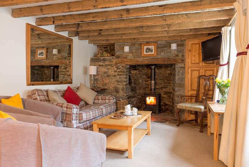 The traditional sitting room with its wood burning stove is at the heart of the house.