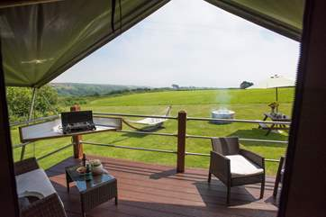 Relax on the decking whilst the children enjoy the space and freedom of this glamping site.