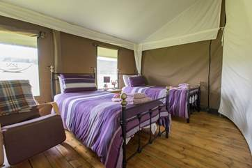 The spacious twin bedroom with lovely bright linens.