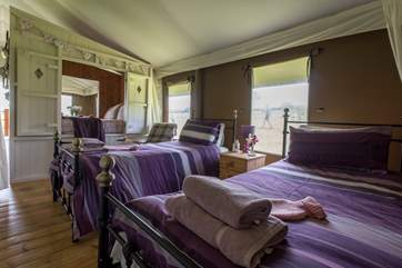Comfortable beds and lovely bright linens - is this really camping?!