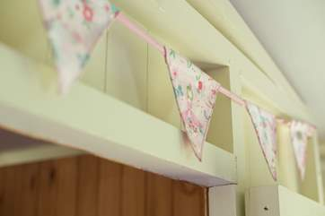 There is pretty bunting around the cabin bed.
