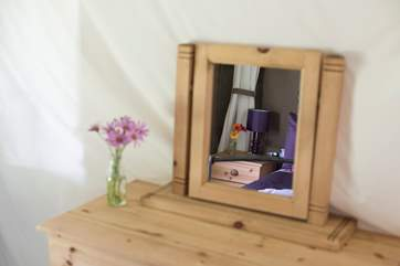 Foxglove's double bedroom has a pine chest of drawers for clothes storage.