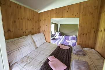 Looking through the cabin bed to the twin bedroom.