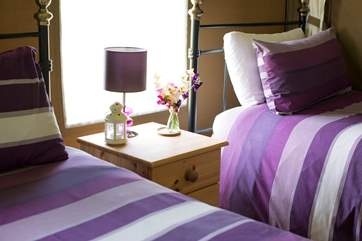 A bedside light is provided in the twin bedroom, perfect for night time reading.