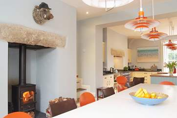 There is a wood-burner at the dining end of the kitchen/dining-room although with under-floor heating throughout the ground floor you are not likely to need it (blizzards being as rare as hens teeth).