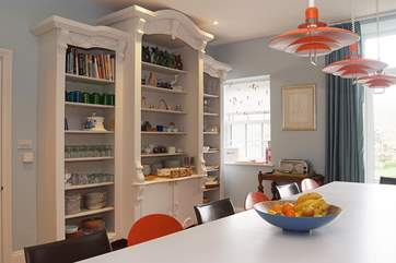 This massive vintage dresser houses all the tableware so its easy to set the table for your meals and a dishwasher at this end of the island unit means it's easy to clear away afterwards!