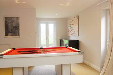 A pool table will help keep everyone occupied if the weather is a little iffy....