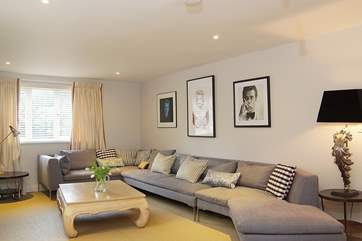 The huge corner sofa has room for all if you want to snuggle up and enjoy a family film night.