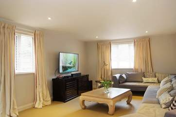 The big wall-mounted TV offers plenty of channels, or bring your favourite DVDs to watch at leisure.
