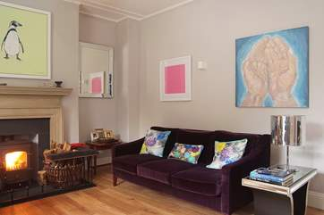 Gorgeous fabrics in wonderful colours mix with an eclectic mix of artwork throughout the house.