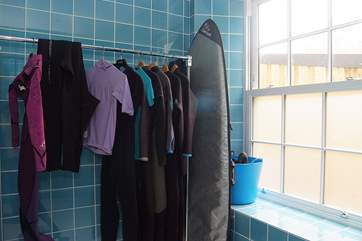 There is plenty of space for wetsuits (and surfboards!) in the wet-room.