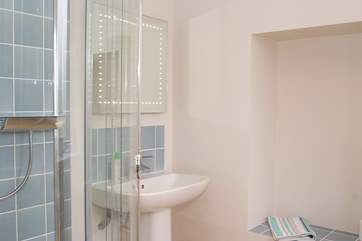 The ground floor shower-room is next to the family/games-room.