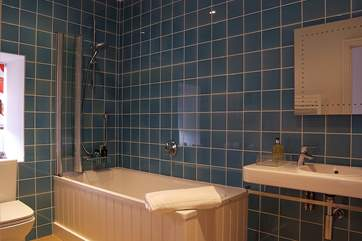 The family bathroom on the first floor has a bath with a fitted shower over.