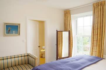 Bedroom 1 looks out over the garden and meadow to the rear.
