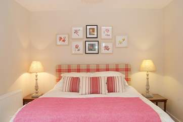There are beautifully themed pictures, cushions and throws in each bedroom.