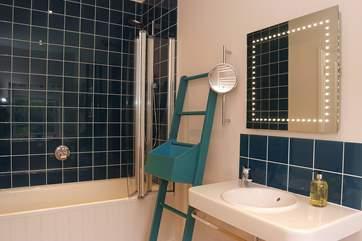 The bathroom en suite to Bedroom 4.