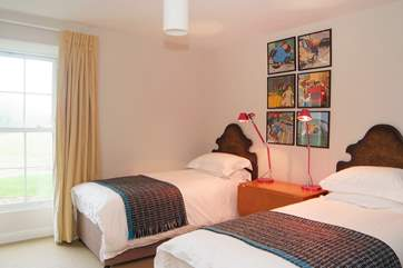 Bedroom 5 has twin beds and looks out over the garden and meadow to the rear.
