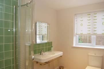 This shower-room is en suite to Bedroom 6.