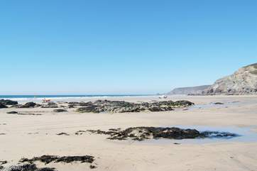Porthtowan beach at low tide, perfect for surfing and buckets and spades (patrolled by RNLI Lifeguards throughout the season).