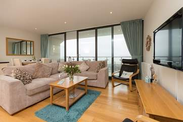 This lovely apartment has a large open plan living/dining/kitchen area with a full width, sea facing balcony.