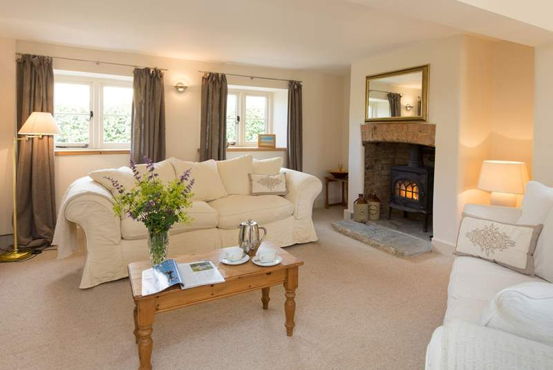 There is a lovely tranquil sitting-room with a wood-burning stove as an extra treat for out-of-season holidays or cool evenings.