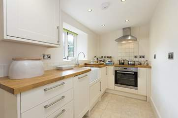 There is a very well-equipped kitchen, with a utility-room beyond it, leading out to the sheltered courtyard.