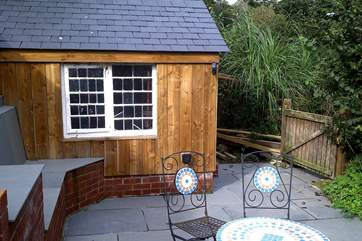 The wooden shack at Little Sandcastle is the perfect home for wetsuits, surfboards or your sandy buckets and spades!
