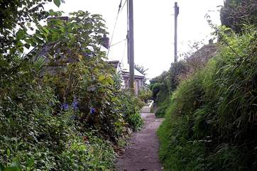 Follow the path down to the cove to visit the pub or take the next right back up to the car park which is shared with Coth Lytherva.