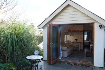 The folding glass doors bring the outside inside.