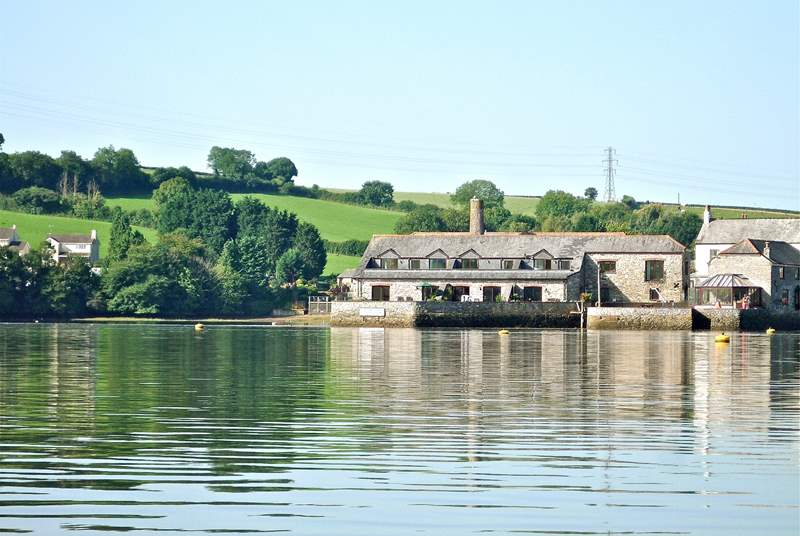 Riverside Cottage is the property on the left of the group of converted buildings with the water on two sides.