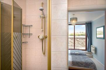 The twin bedroom has its own en suite shower-room.
