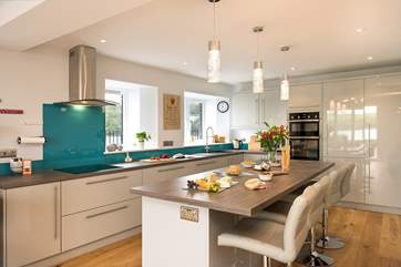The modern kitchen has a breakfast bar ideal for enjoying a morning coffee or glass of wine whilst keeping the cook company of course!