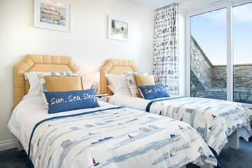The delightful twin bedroom with sliding doors leading out to the balcony
