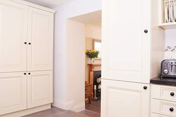 The kitchen has a wide arch through to the dining-room making this feel sociable and inclusive. Take care of the step between the two rooms.