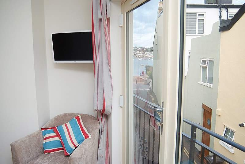 There is a glimpse of the water from the living-room window which has a Juliet balcony.