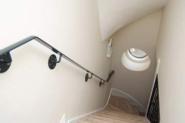 The stairs up from the ground floor to the open plan living-room and Bedroom 1.