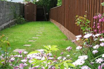 Steps lead up from the courtyard to this lovely fully enclosed garden.