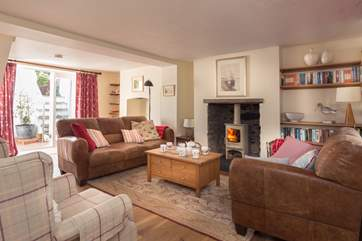 There is a wonderfully cosy sitting-room with French windows out to the patio and garden