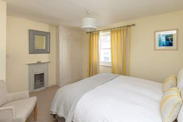 The bedroom has its original Victorian cast iron fireplace as a pretty feature
