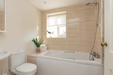 This is the family bathroom on the first floor, offering a bath as well as the fitted shower.