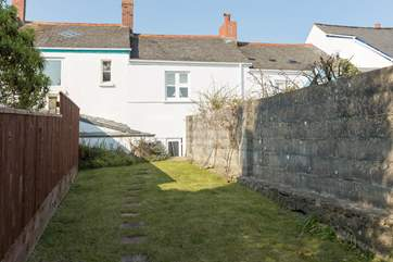 Tydemans is in fact two cottages converted skilfully into one.  This is the view from the back of the fully enclosed garden. A small flight of steps lead up from the courtyard area.