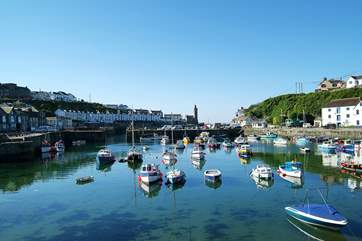 Porthleven's picturesque harbour with its array of restaurants, pubs and shops is a short drive away.