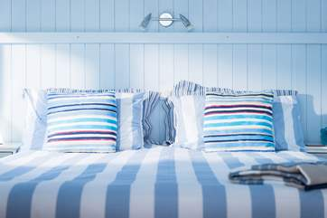 Bright and comfortable linens on the king-size bed make it an inviting place to be after a day out exploring.