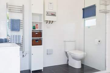 The spacious shower-room is located in your very own 'beach hut' behind Mr Blue Sky. It even has a heated towel rail and hair-dryer too.