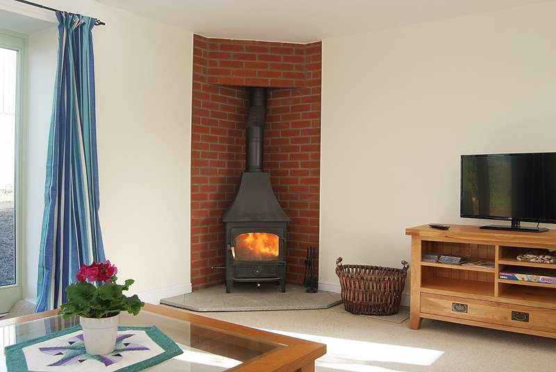 This chunky wood-burner will keep you toasty warm in even the coldest weather (although with modern insulation, double-glazing and full contemporary electric central heating you'll barely need it!).