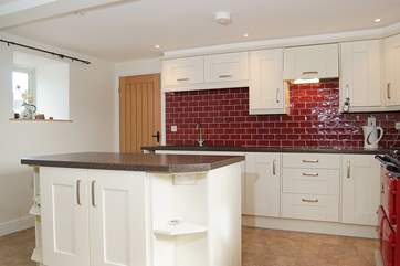 There is a separate utility-room off the kitchen with a second electric hob, washing machine and dishwasher.